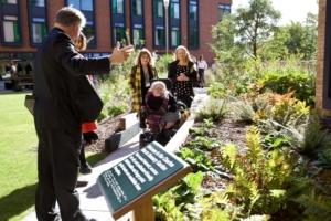 Stakeholders getting a tour of the Sensory Garden